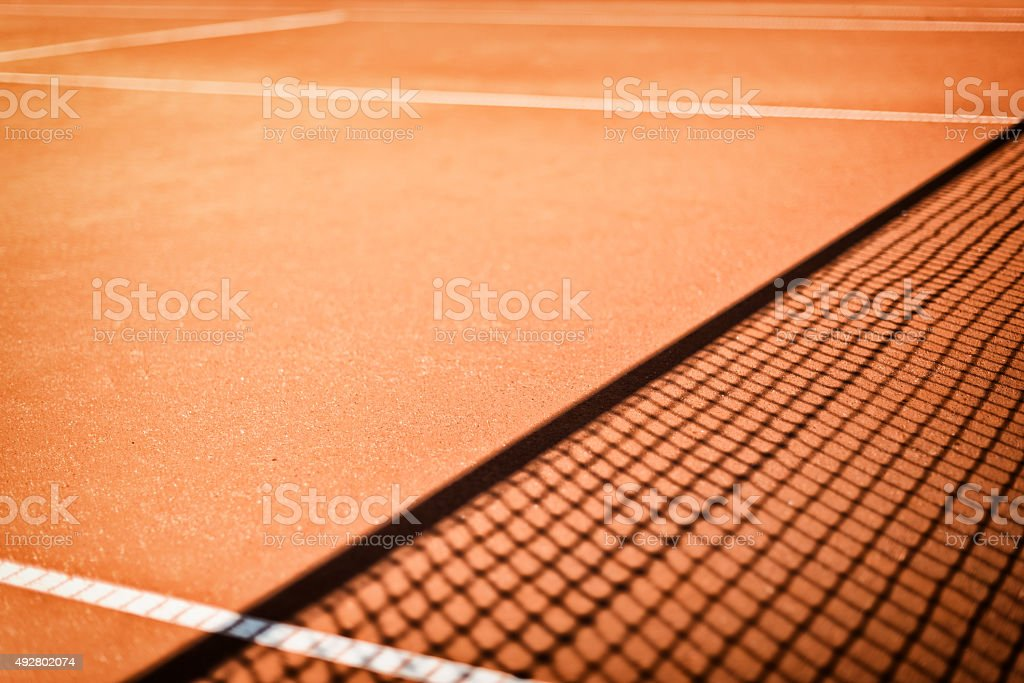 tennis net shadow outdoors on clay court stock photo
