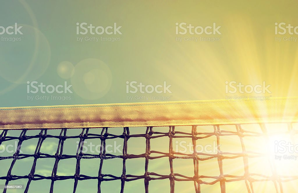 Tennis net with sunset sky stock photo