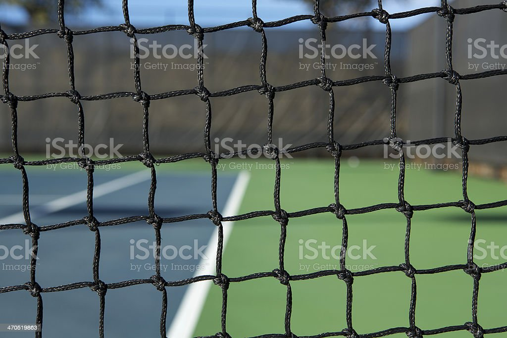 Tennis Net with the Court Beyond royalty-free stock photo