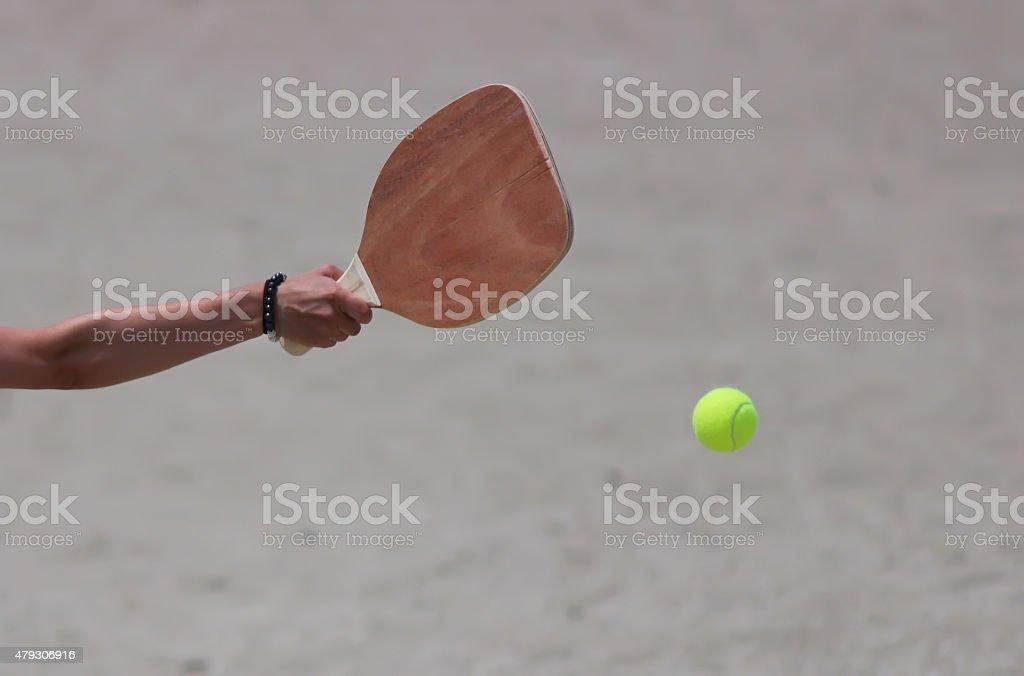 Tennis on the beach stock photo
