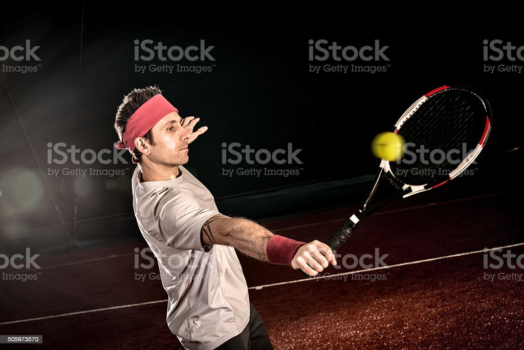Tennis player action: Backhand volée stock photo