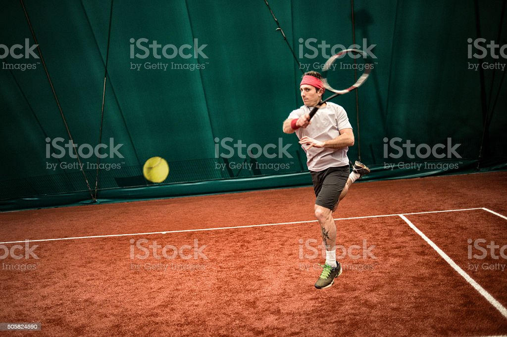 Tennis player action: Jumping forehand stock photo