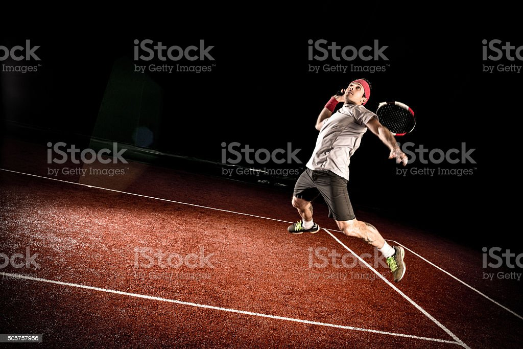 Tennis player action: Jumping smash stock photo
