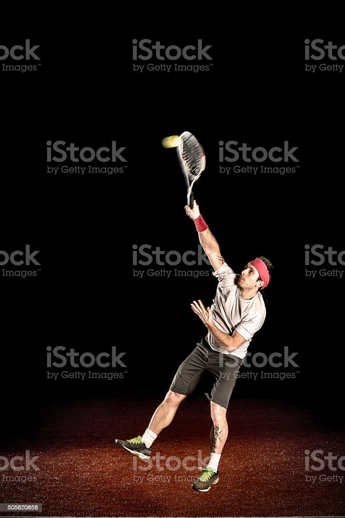 Tennis player action: Serving stock photo