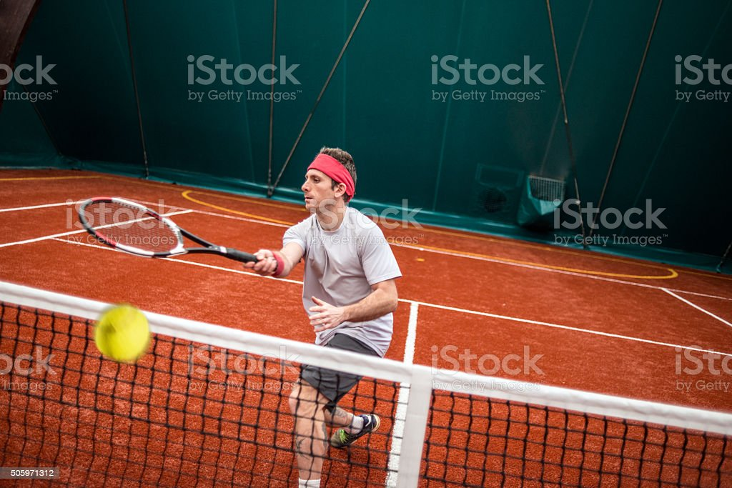 Tennis player action: Forehand volée stock photo