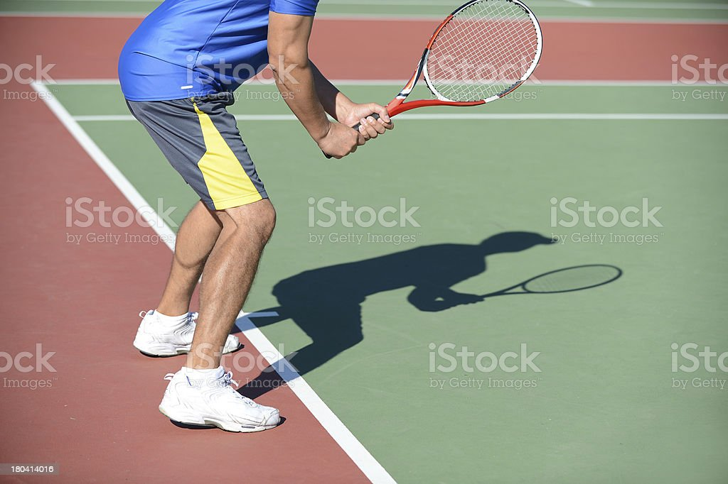 Tennis Player and Shadow on Court royalty-free stock photo