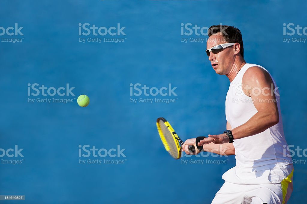 Tennis player at forehand royalty-free stock photo