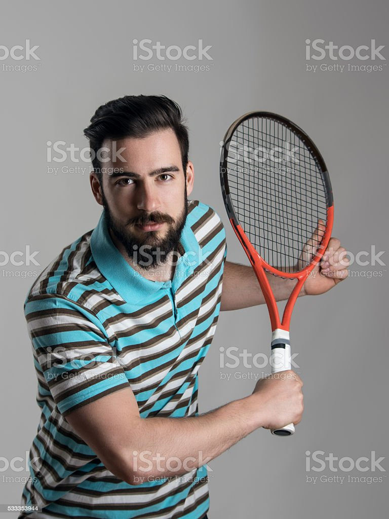 Tennis player bend holding racket and waiting for serve stock photo