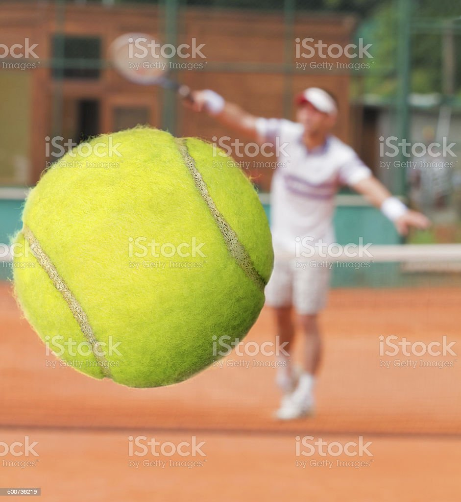 Tennis player hitting a ball with a forehand. stock photo