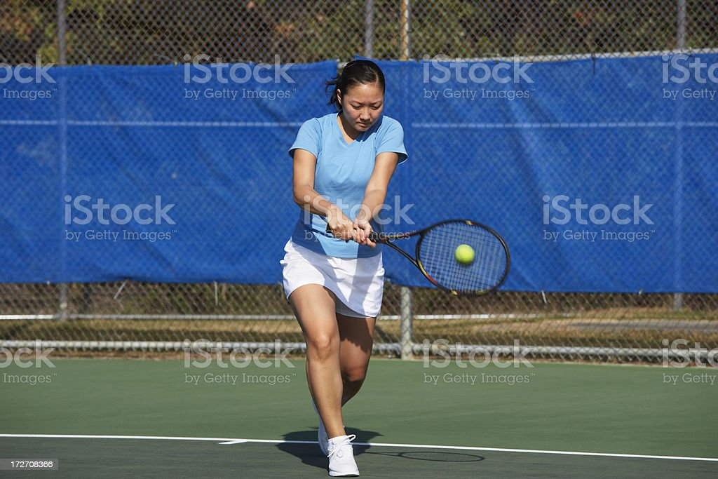 Tennis player hitting backhand royalty-free stock photo