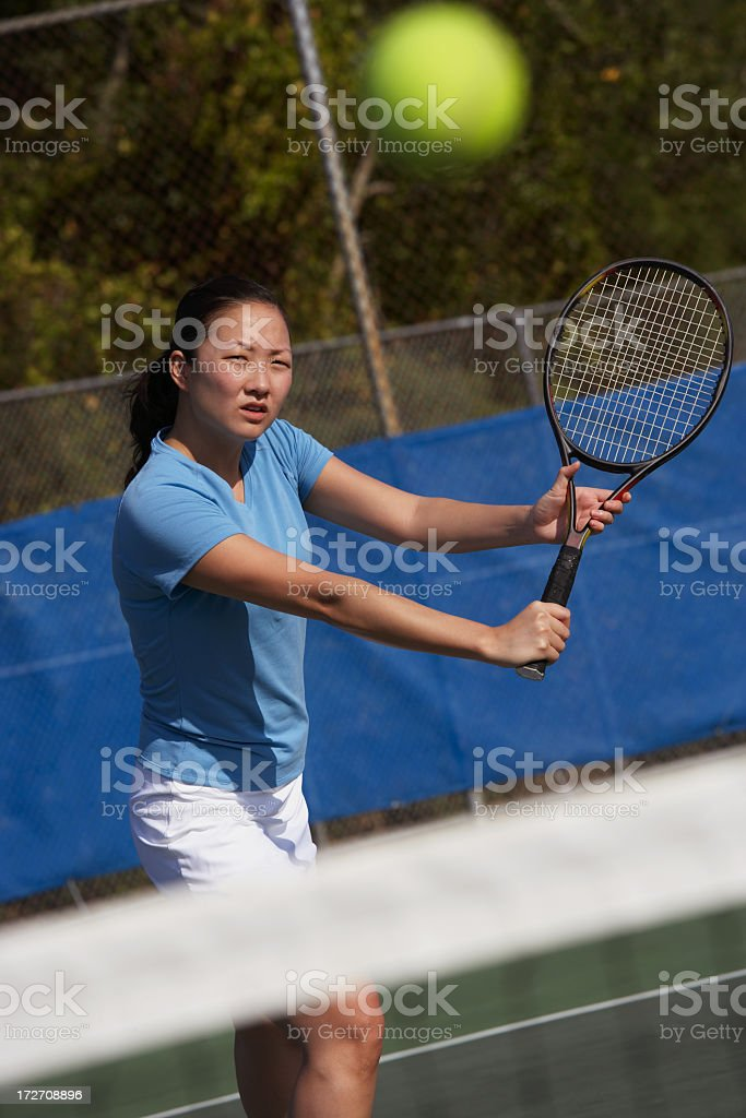 Tennis player hitting backhand volley royalty-free stock photo