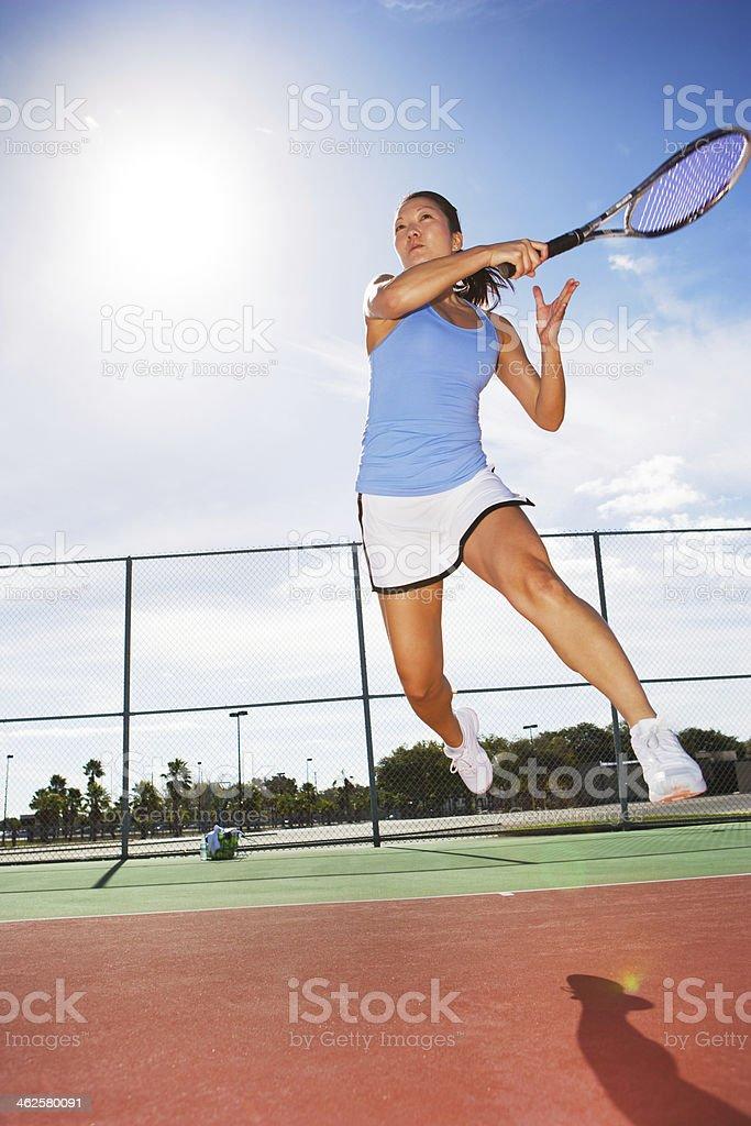 Tennis player hitting forehand stock photo