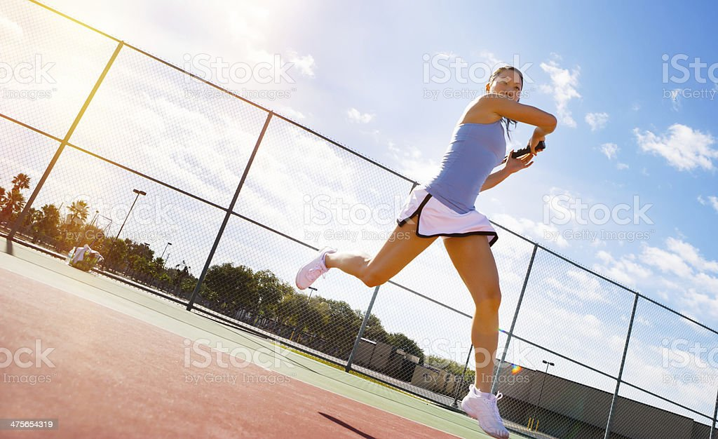 Tennis player hitting forehand stock photo