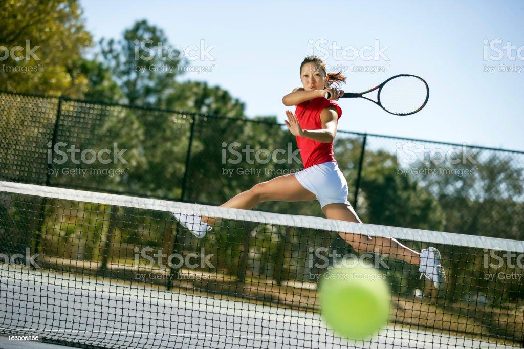 Tennis player hitting forehand winner stock photo