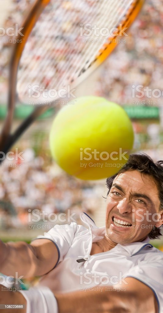 Tennis player hitting the ball royalty-free stock photo