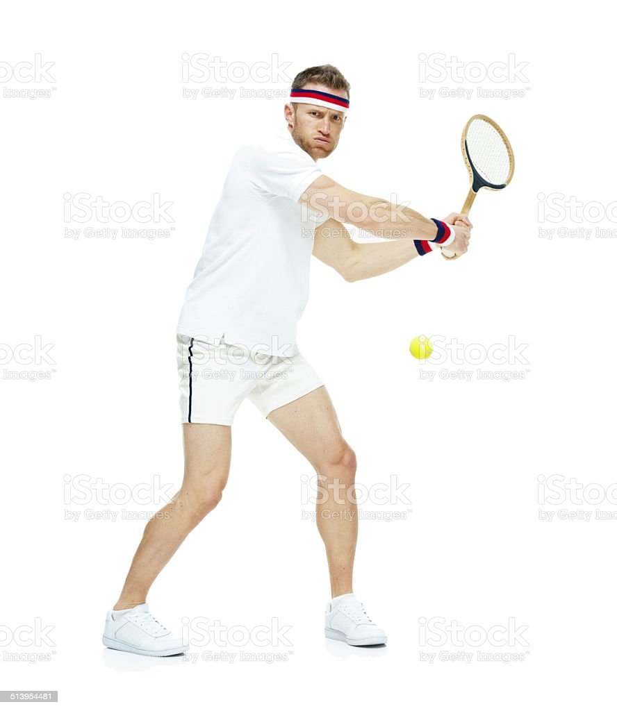 Tennis player hitting the ball stock photo