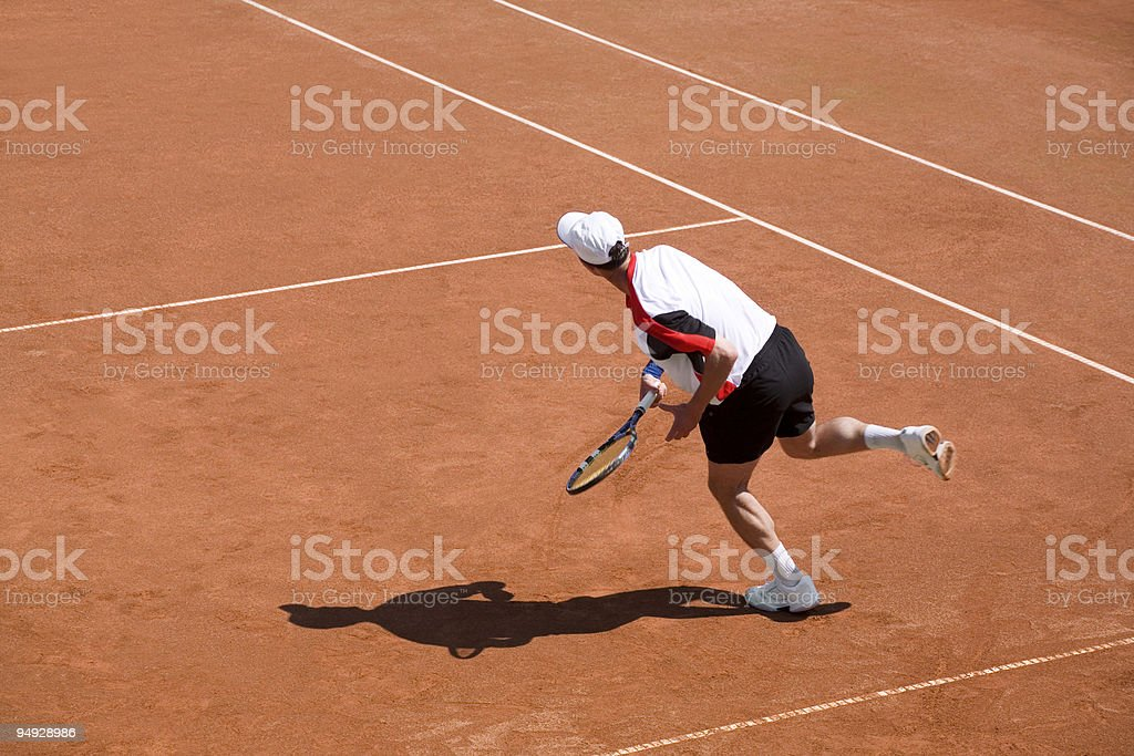 Tennis player hitting the ball royalty-free stock photo