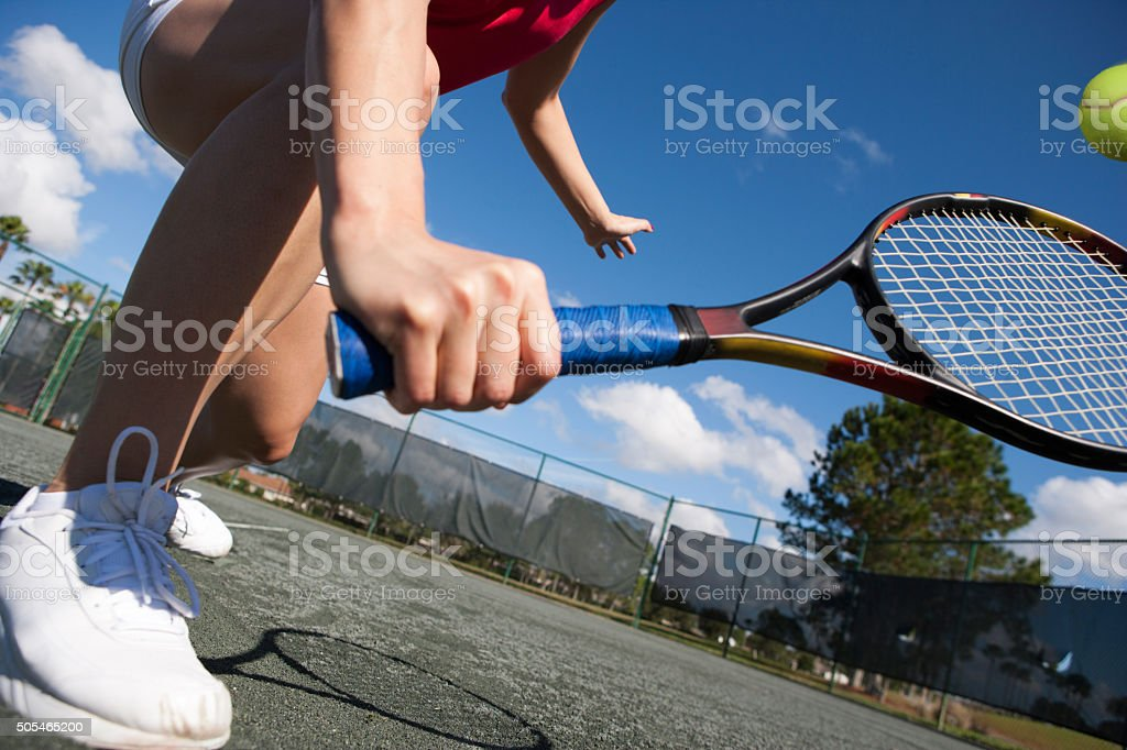 Tennis player hitting volley on har-tru tennis court stock photo