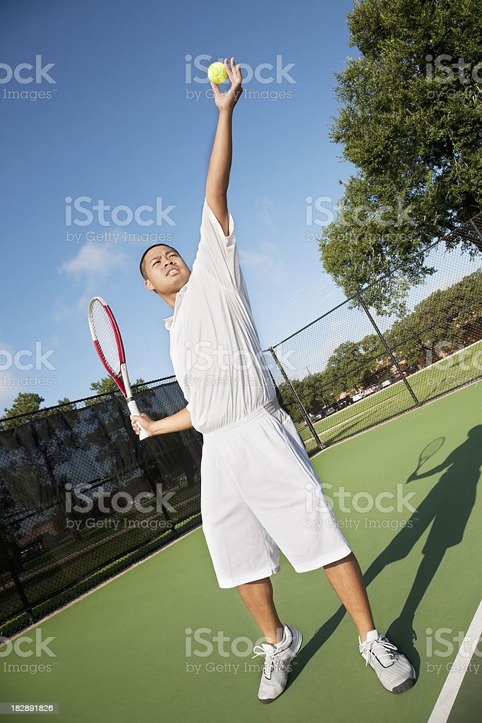 Tennis Player Holding Ball Up About to Serve royalty-free stock photo
