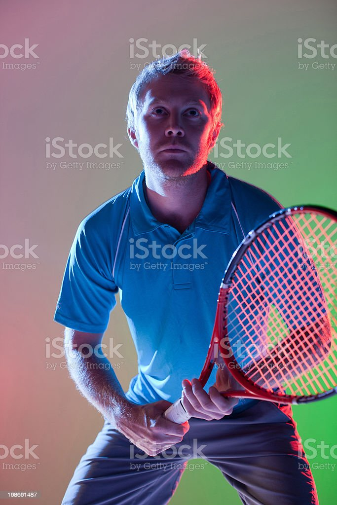 Tennis player holding racket royalty-free stock photo