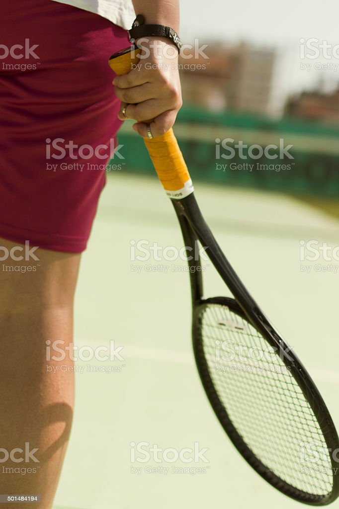 tennis player holding the racket. stock photo