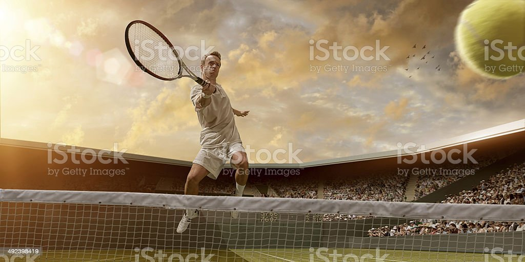 Tennis Player in Mid Air Volley stock photo