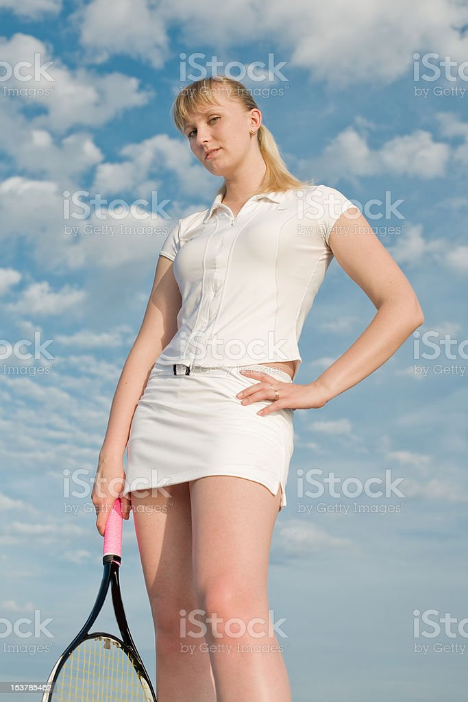 Tennis player looking at camera royalty-free stock photo