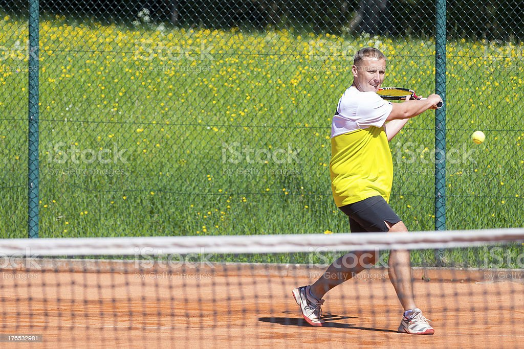 tennis player on court makes return royalty-free stock photo