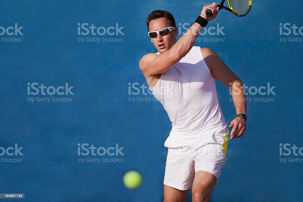Tennis player on the blue background stock photo