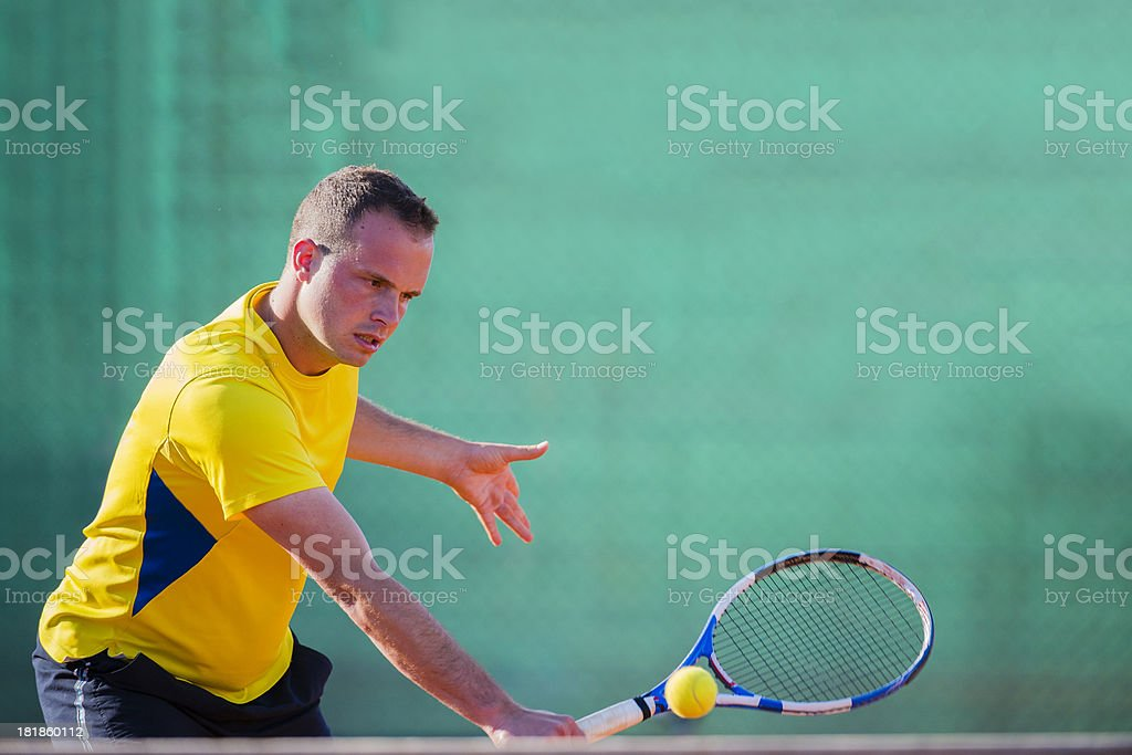 Tennis Player Performing Backhand Volley on the Net royalty-free stock photo