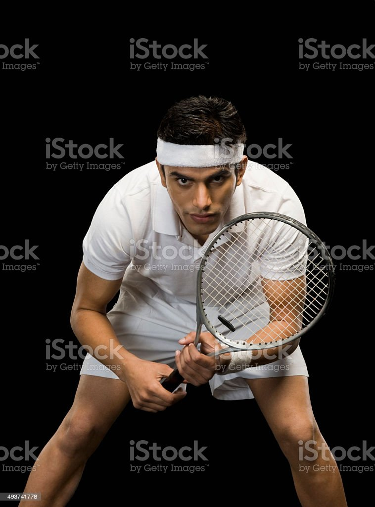 Tennis player practicing with a tennis racket stock photo