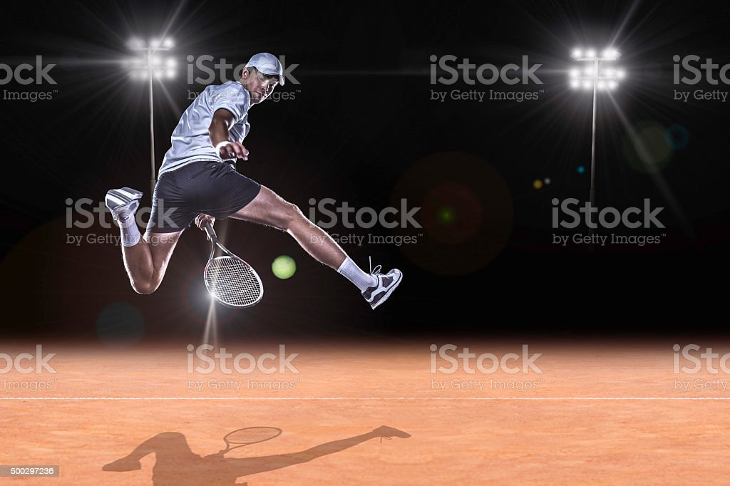 Tennis player reaching for the hard ball stock photo