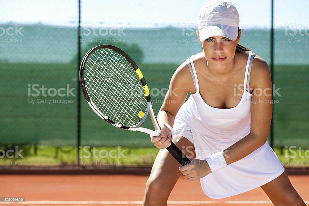 tennis player ready for a serve stock photo