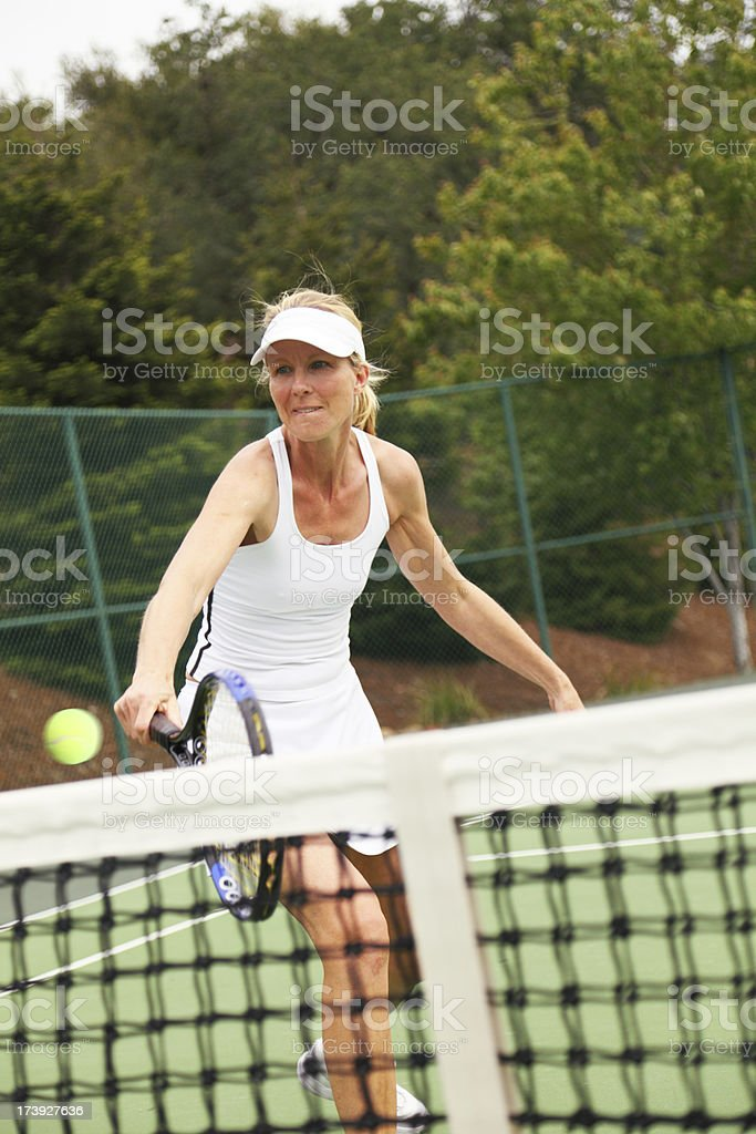 Tennis Player Returning The Ball royalty-free stock photo
