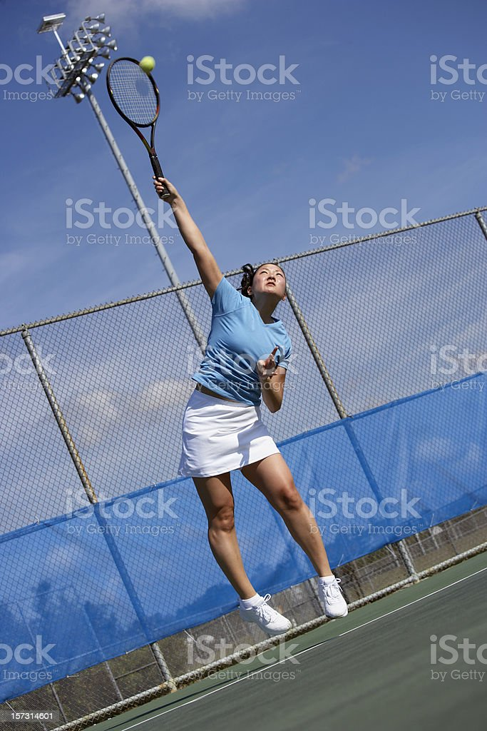 Tennis player serves royalty-free stock photo