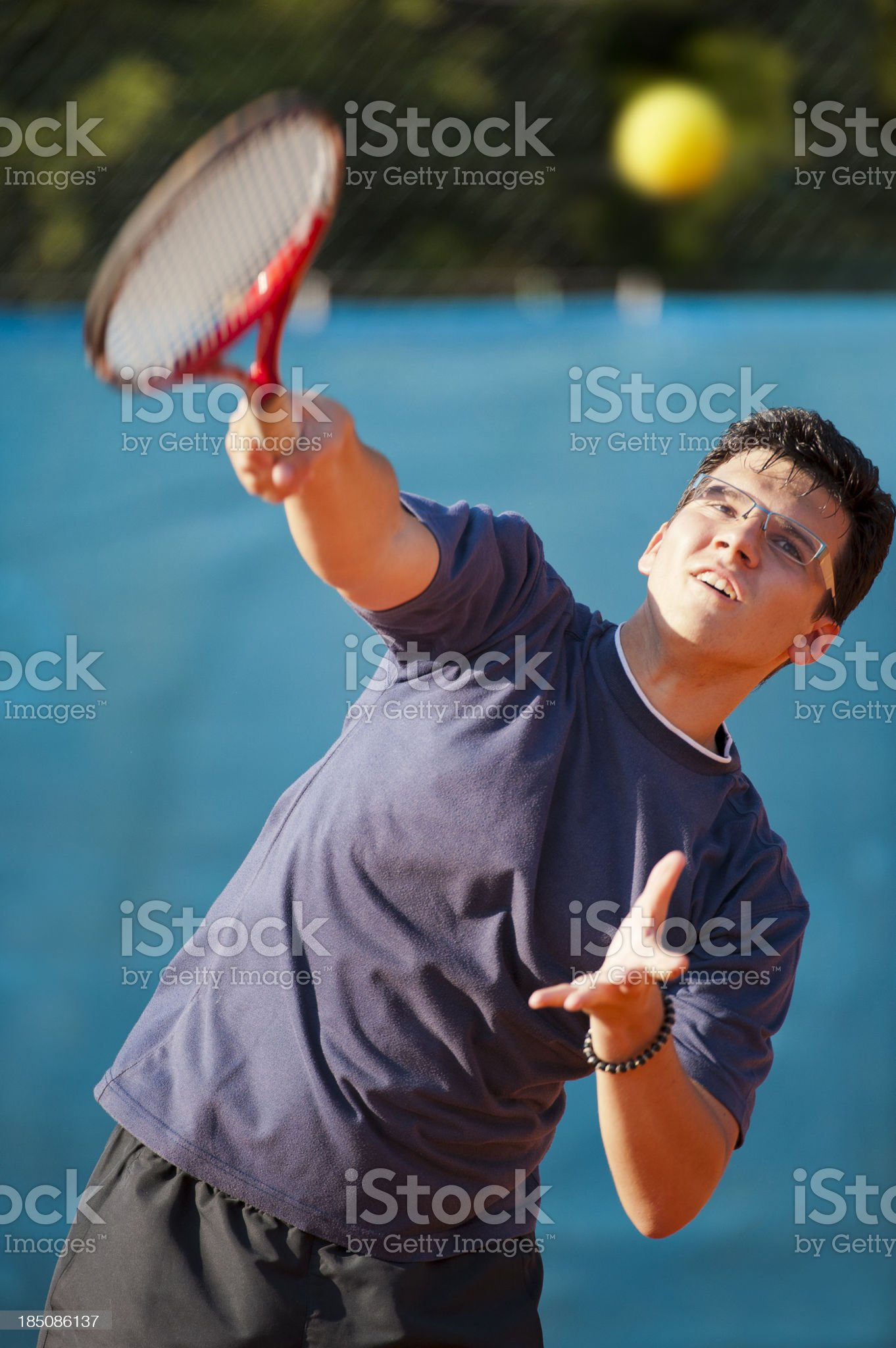 Tennis player serving royalty-free stock photo