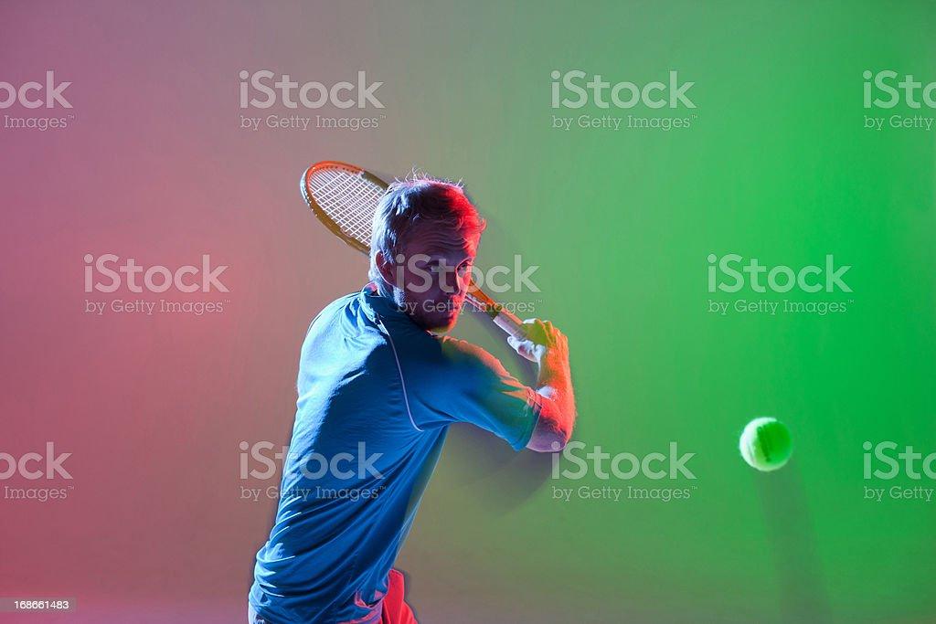 Tennis player swinging racket stock photo
