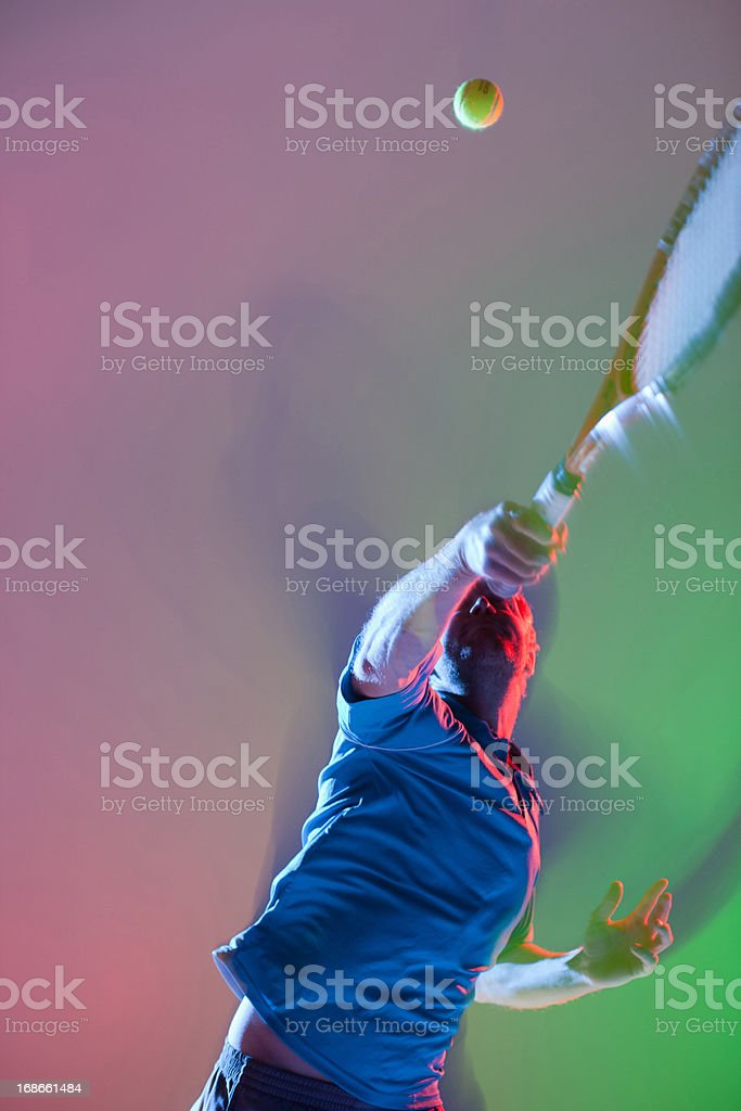 Tennis player swinging racket stock photo