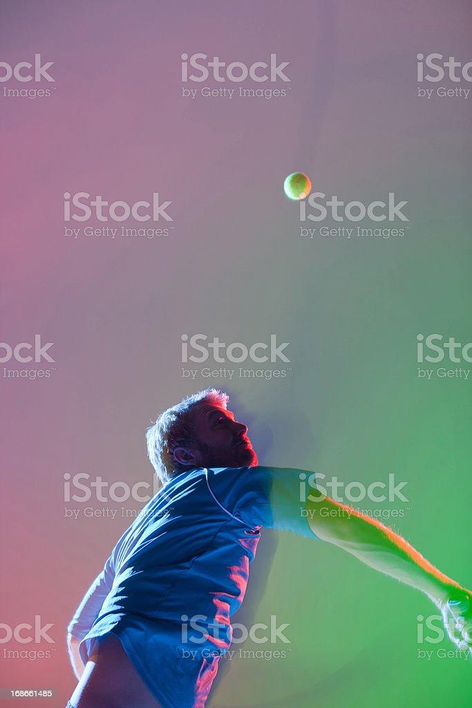 Tennis player swinging racket royalty-free stock photo