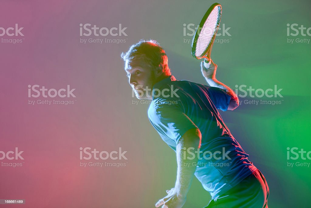 Tennis player swinging racket royalty-free stock photo