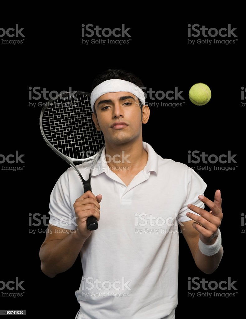 Tennis player with a tennis racket and a ball stock photo