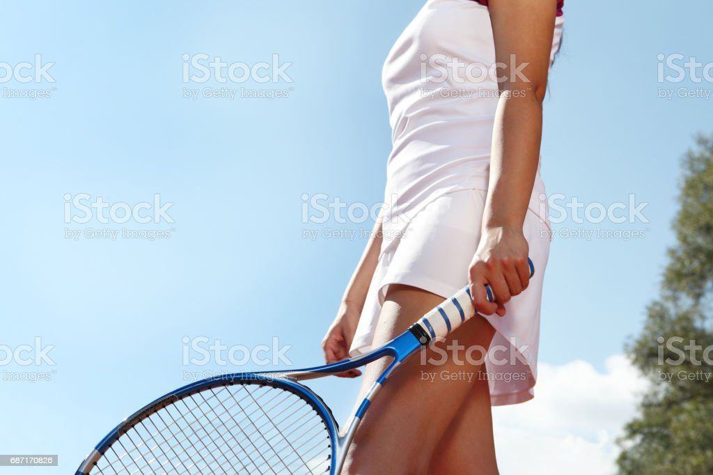 tennis player with racket during a match game, isolated stock photo