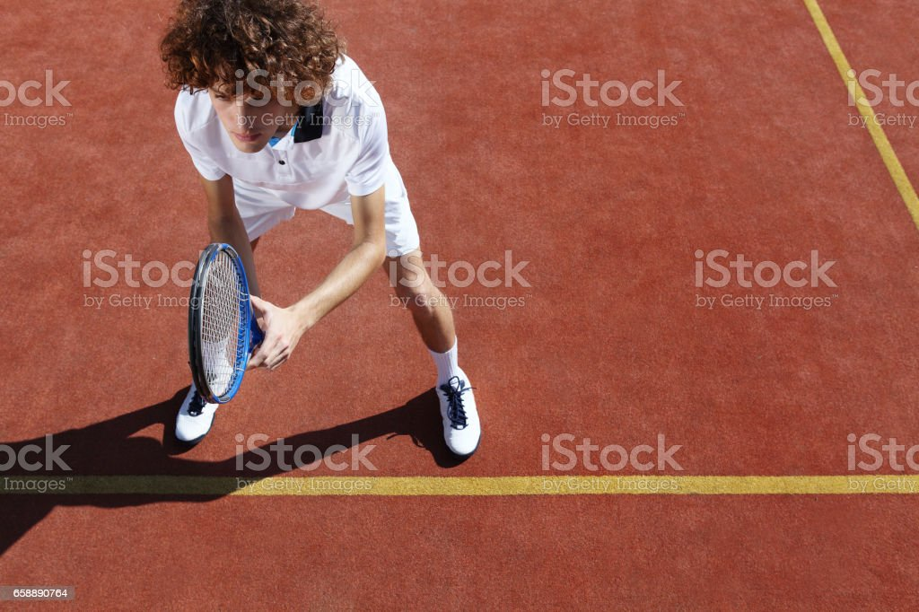 tennis player with racket during a match game stock photo