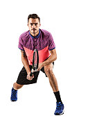 Tennis player with racket ready to hit a tennis ball