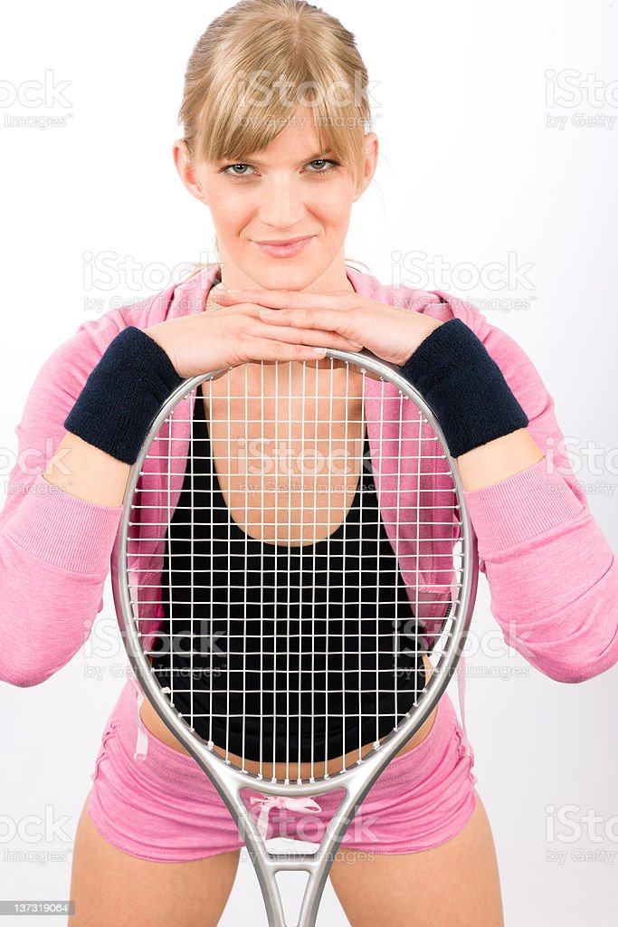 Tennis player woman young smiling leaning racket royalty-free stock photo