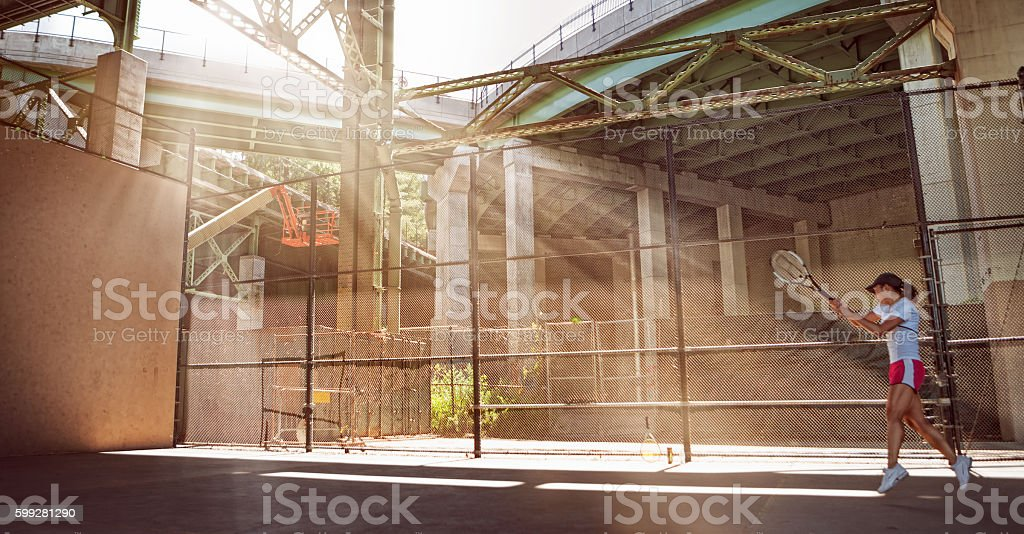 Tennis player workout in under highway stock photo