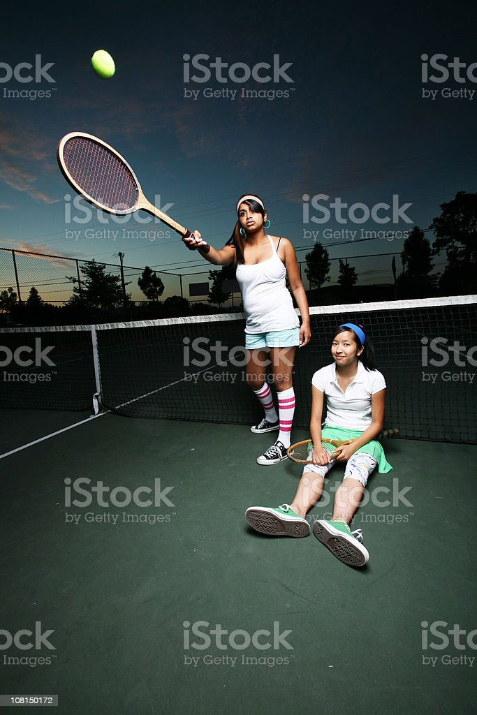 Tennis Players at Night royalty-free stock photo