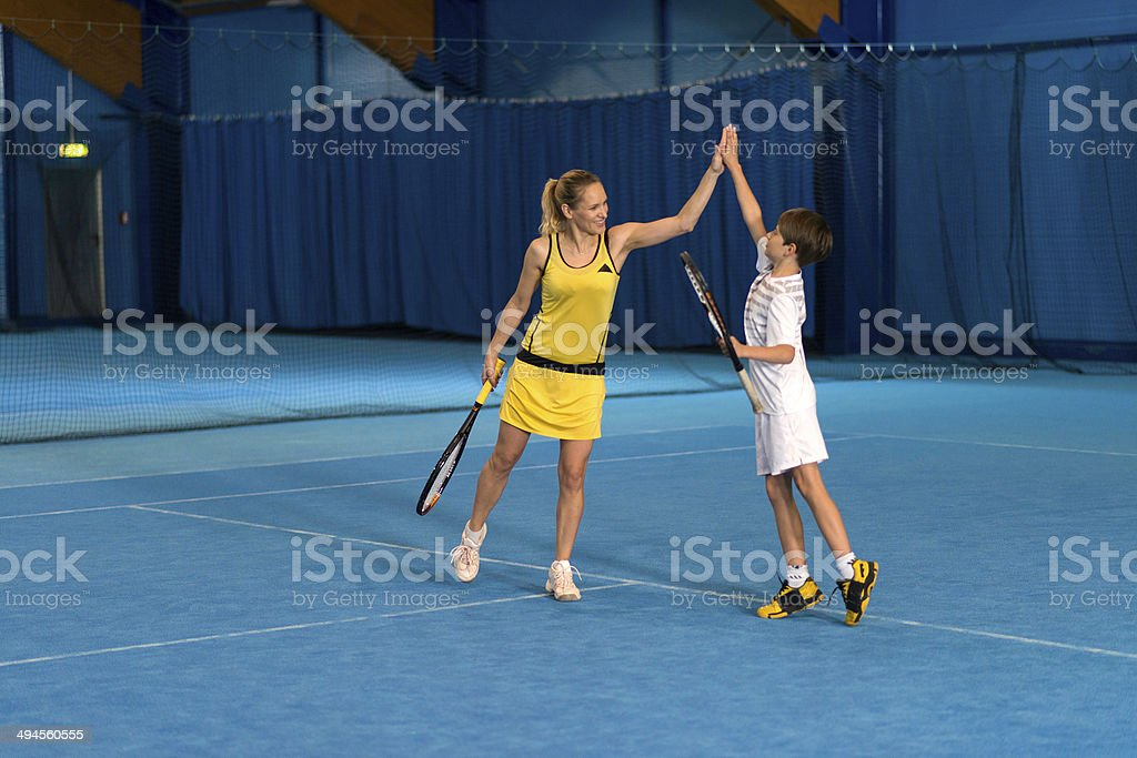 Tennis Players Giving A High Five stock photo