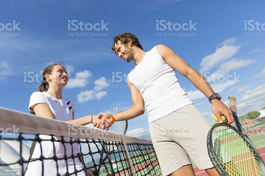 Tennis Players Giving Handshake royalty-free stock photo