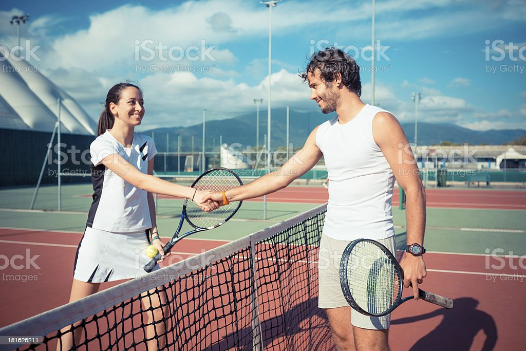 Tennis Players Giving Handshake royalty-free stock photo